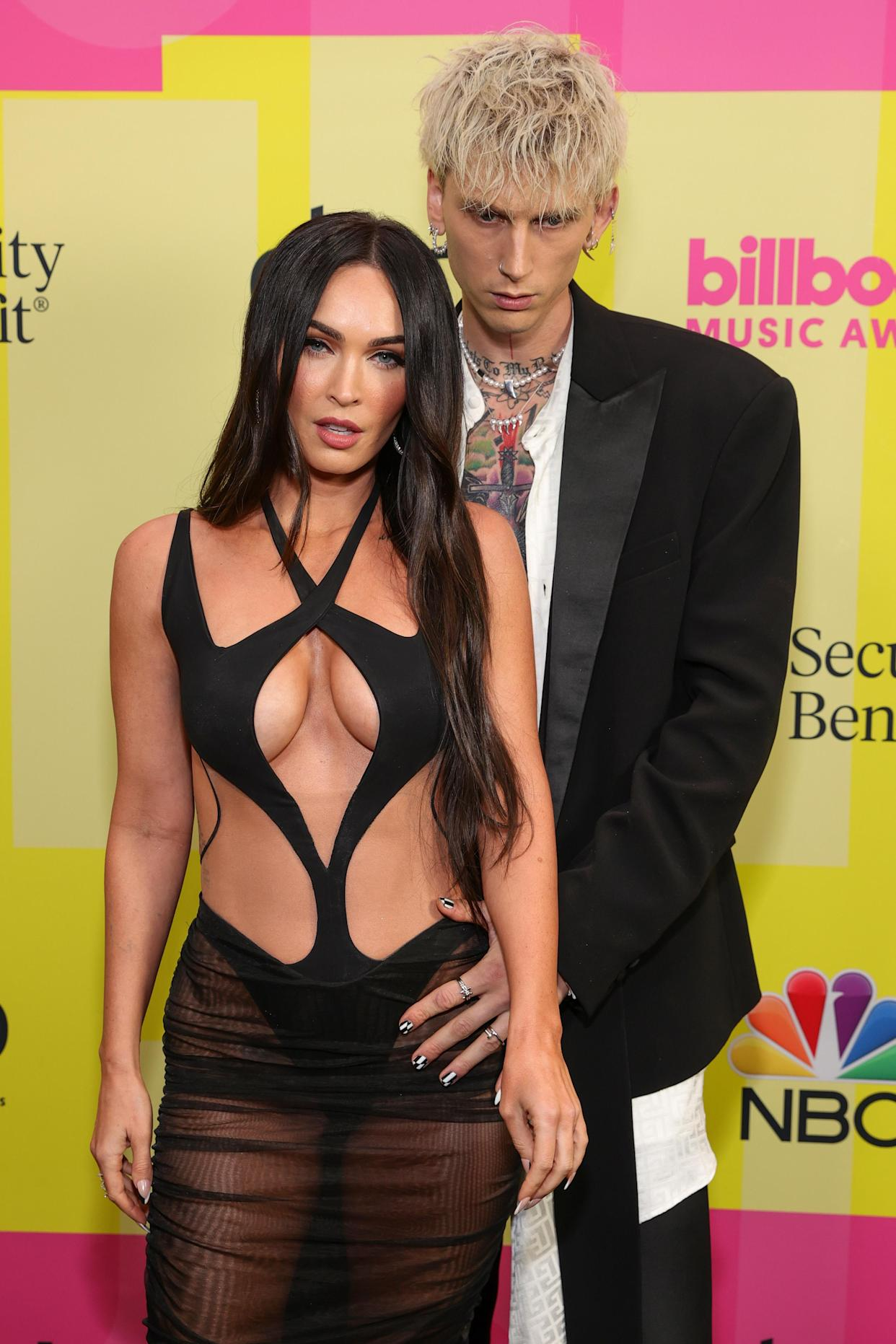 LOS ANGELES, CALIFORNIA - MAY 23: Machine Gun Kelly and Megan Fox poses backstage for the 2021 Billboard Music Awards, broadcast on May 23, 2021 at Microsoft Theater in Los Angeles, California. (Photo by Rich Fury/Getty Images for dcp)