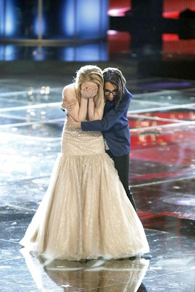 "In this image provided by NBC Danielle Bradbery gets a hug from Michelle Chamuel after learning she won season-four of ""The Voice"" Tuesday June 18, 2013. Bradbery won, Chamuel is the runner-up. Bradbery never had a big singing gig or a vocal lesson. (AP Photo/NBC, Tyler Golden)"