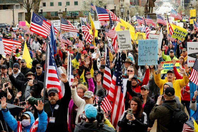 Demonstrators take part in a rally to demand the reopening of businesses in the US state of Michigan (AFP Photo/JEFF KOWALSKY)