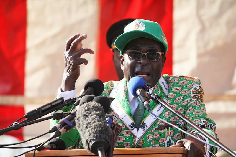 FILE - In this Friday, July, 5, 2013, file photo, Zimbabwean President Robert Mugabe delivers his speech at the launch of his party's election campaign in Harare, Zimbabwe. Mugabe is on the campaign trail, seeking to extend his grip on Zimbabwe in an election next week that observers fear will be marred by fraud. But the opposition is gambling that there is enough discontent to unseat the wily political survivor, who has been in power for 33 years. (AP Photo/Tsvangirayi Mukwazhi, File)