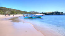 """<p>There are only seven pink beaches in the world (including that<a href=""""https://www.thrillist.com/travel/nation/best-caribbean-vacation-spots-st-croix-puerto-rico-and-dominican-republic"""" rel=""""nofollow noopener"""" target=""""_blank"""" data-ylk=""""slk:underrated one in the Bahamas"""" class=""""link rapid-noclick-resp""""> underrated one in the Bahamas</a> we already told you about), all of them formed when bits of red coral mix with white sand. This one on Komodo Island in Komodo National Park might be the loneliest of the seven, nestled on a far flung stretch in Indonesia and home to nothing but wilderness and those famous dragon. (Photo: <a href=""""https://www.flickr.com/photos/schristia/14881246434/in/photolist-oF1h7o-6iPoaf-d3HSK-eVRB3o-di8VXy-35PyPu-e5Wujm-bLERtP-s5HRKj"""" rel=""""nofollow noopener"""" target=""""_blank"""" data-ylk=""""slk:Schristina"""" class=""""link rapid-noclick-resp"""">Schristina</a>/Flickr)</p>"""