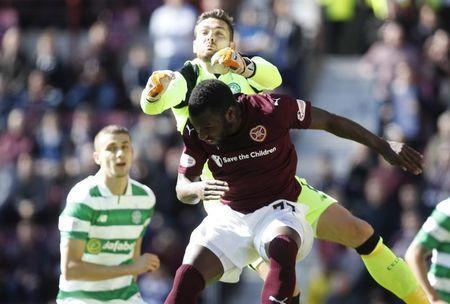 Britain Football Soccer - Heart of Midlothian v Celtic - Scottish Premiership - Tynecastle - 2/4/17 Heart's Esmael Goncalves in action with Celtic's Craig Gordon Reuters / Russell Cheyne Livepic