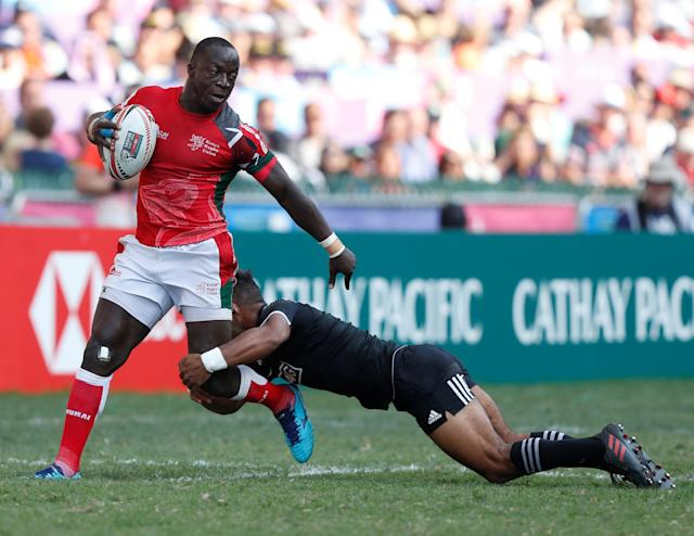 Rugby Union - Kenya v New Zealand - World Rugby Sevens Series - Hong Kong Stadium, Hong Kong, China - April 8, 2018 - Kenya's Jeffrey Oluoch is tackled by New Zealand's Jona Nareki. REUTERS/Bobby Yip