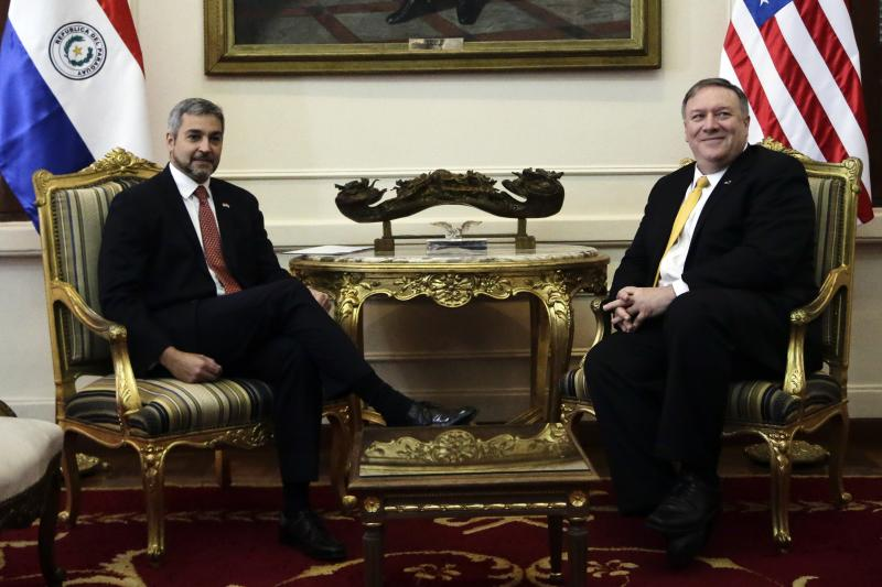"U.S. Secretary of State Mike Pompeo, right, smiles for a picture with Paraguay's President Mario Abdo Benitez, during official meeting at ""Palacio de Lopez"", in Asuncion, Paraguay, Saturday, April 13, 2019. Pompeo is in the second of four countries' tour that includes Chile, Peru and Colombia to address, mainly, the crisis in Venezuela. (AP Photo/Jorge Saenz)"