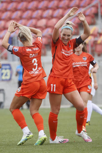 Houston Dash forward Rachel Daly (3) celebrates with teammate Megan Oyster (11) after scoring against Utah Royals FC during the first half of an NWSL Challenge Cup soccer match at Zions Bank Stadium Tuesday, June 30, 2020, in Herriman, Utah. (AP Photo/Rick Bowmer)