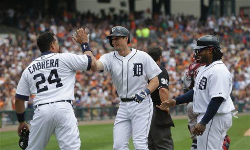 Detroit Tigers' Miguel Cabrera and Prince Fielder, right, congratulate Don Kelly, center, after his three-run home run during the sixth inning of a baseball game against the Cleveland Indians in Detroit, Sunday, June 9, 2013. (AP Photo/Carlos Osorio)