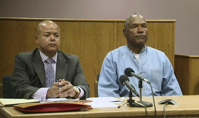<p>Former NFL football star O.J. Simpson appears with his attorney, Malcolm LaVergne, left, via video for his parole hearing at the Lovelock Correctional Center in Lovelock, Nev., on Thursday, July 20, 2017. Simpson was convicted in 2008 of enlisting some men he barely knew, including two who had guns, to retrieve from two sports collectibles sellers some items that Simpson said were stolen from him a decade earlier. (KOLO-TV via AP, Pool) </p>