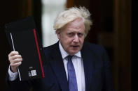 British Prime Minister Boris Johnson leaves 10 Downing Street, making his way to Parliament to debate the situation in Afghanistan, in London, Wednesday Aug. 18, 2021. Johnson is set to update lawmakers Wednesday about the evacuation of British nationals and local allies from Afghanistan. (AP Photo/Alberto Pezzali)
