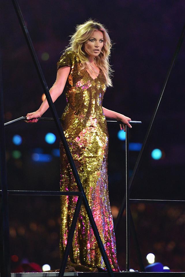 """Kate Moss decided to go for the gold at the London Summer Olympics' Closing Ceremony on Sunday and looked positively statuesque in a dazzling Alexander McQueen sequin gown. The 38-year-old was joined by a gaggle of other British models including Naomi Campbell and Georgia May Jagger as they strutted their stuff on the catwalk to the David Bowie tune """"Fashion."""" """"I suspect Kate Moss might fail her drugs test later. #closingceremony,"""" a snarky Piers Morgan tweeted afterwards. (8/12/2012)"""