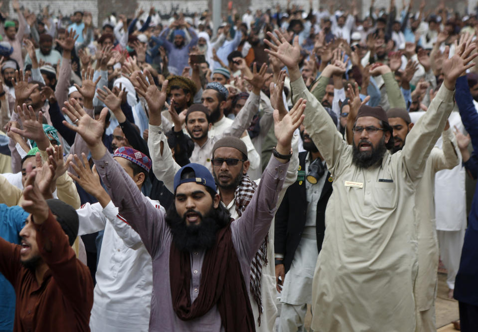 Supporters of Tehreek-e-Labiak Pakistan, a radical Islamist political party, chant slogans during a sit-in protest against the arrest of their party leader Saad Rizvi and demanding to expel the French envoy from the country, in Lahore, Pakistan, Friday, April 16, 2021. Pakistan briefly blocked access to all social media on Friday, after days of anti-French protests across the country by radical Islamists opposed to cartoons they consider blasphemous. (AP Photo/K.M. Chaudary)