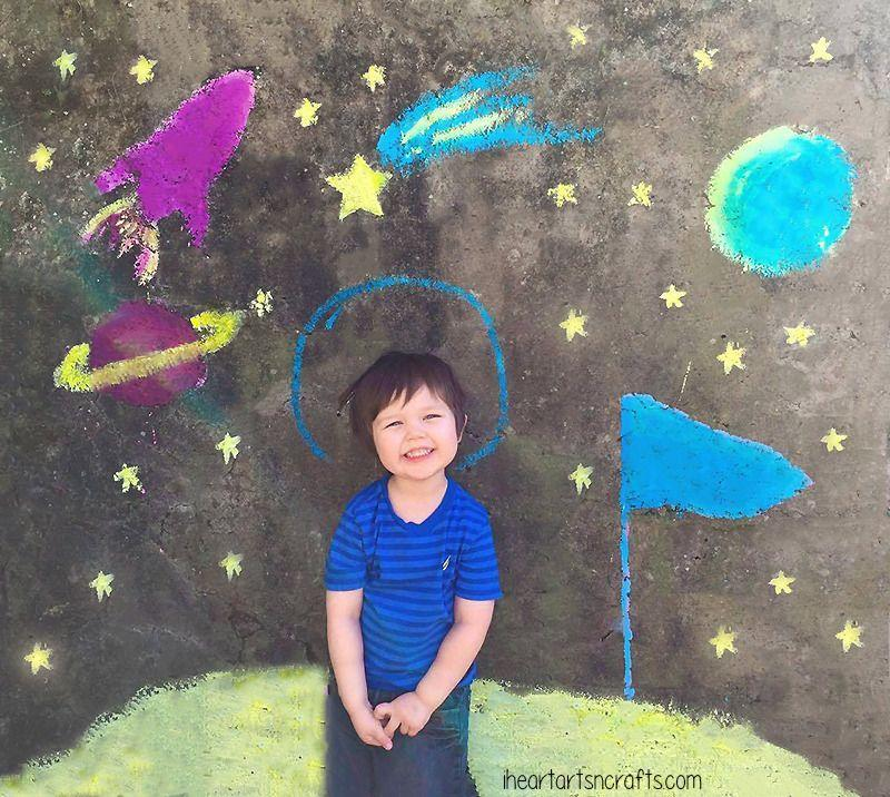 """<p>Launch your child into outer space — in their imagination — with this simple backdrop idea. Draw some stars, a rocket, a planet — and draw a circle around your child's head to represent an astronaut's helmet as you stand above for a perfect picture.</p><p><em><a href=""""https://www.iheartartsncrafts.com/12-super-fun-ways-play-sidewalk-chalk/"""" rel=""""nofollow noopener"""" target=""""_blank"""" data-ylk=""""slk:Get the tutorial from I Heart Arts N Crafts »"""" class=""""link rapid-noclick-resp"""">Get the tutorial from I Heart Arts N Crafts »</a></em></p>"""