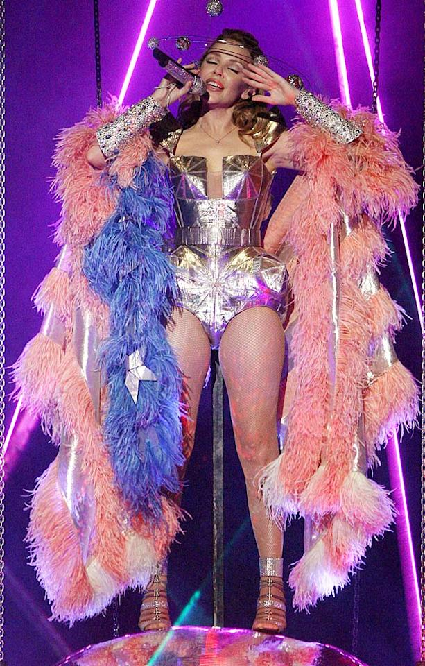 "It may be a costume for her current concert tour, but Aussie pop diva Kylie Minogue's futuristic Jean Paul Gaultier ensemble, complete with an armored bustier, bejeweled cuffs, and orb-enhanced headdress, is out of this world! Frank Micelotta/<a href=""http://www.gettyimages.com/"" target=""new"">GettyImages.com</a> - September 30, 2009"