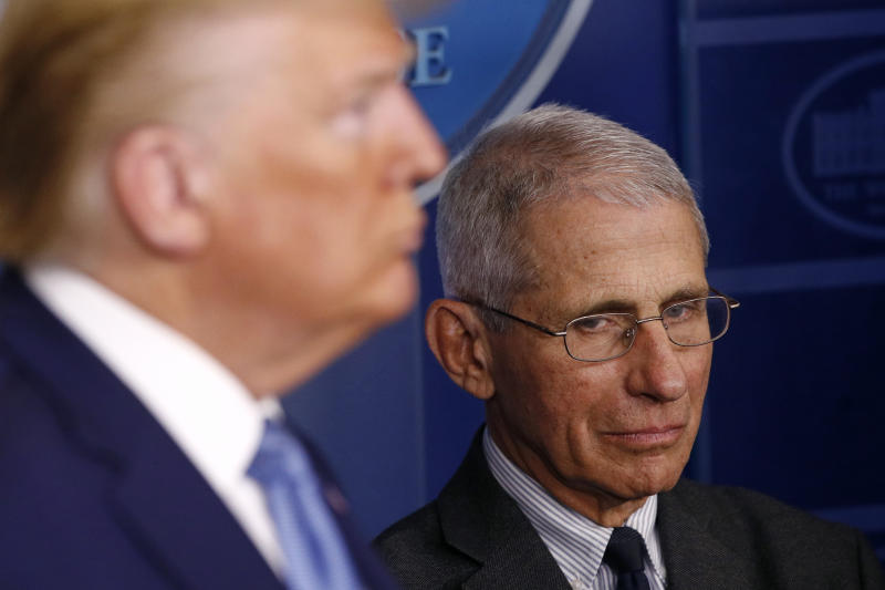 Director of the National Institute of Allergy and Infectious Diseases Dr. Anthony Fauci, right, and President Donald Trump listen as Vice President Mike Pence speaks during a coronavirus task force briefing at the White House, Saturday, March 21, 2020, in Washington. (AP Photo/Patrick Semansky)
