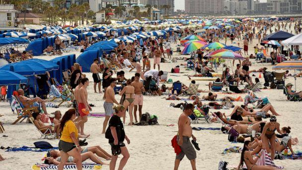 PHOTO: In this March 17, 2020, file photo, people crowd the beach in Clearwater, Fla. (Steve Nesius/Reuters, FILE)