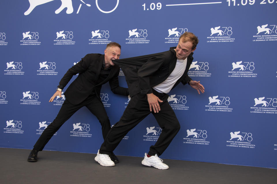 FILE - In this Sept, 8, 2021 file photo Timofey Tribuntsev, left, and Yuriy Borisov pose for photographers at the photo call for the film 'Kapitan Volkonogov Bezhal' during the 78th edition of the Venice Film Festival in Venice, Italy (Photo by Joel C Ryan/Invision/AP, File)