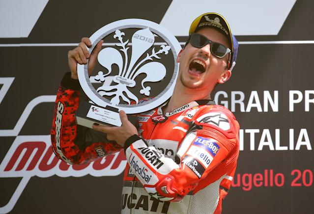 Motorcycling - MotoGP - Italian Grand Prix - Mugello Circuit, Scarperia, Italy - June 3, 2018 Ducati Team's Jorge Lorenzo celebrates winning the race with the trophy on the podium REUTERS/Alessandro Bianchi