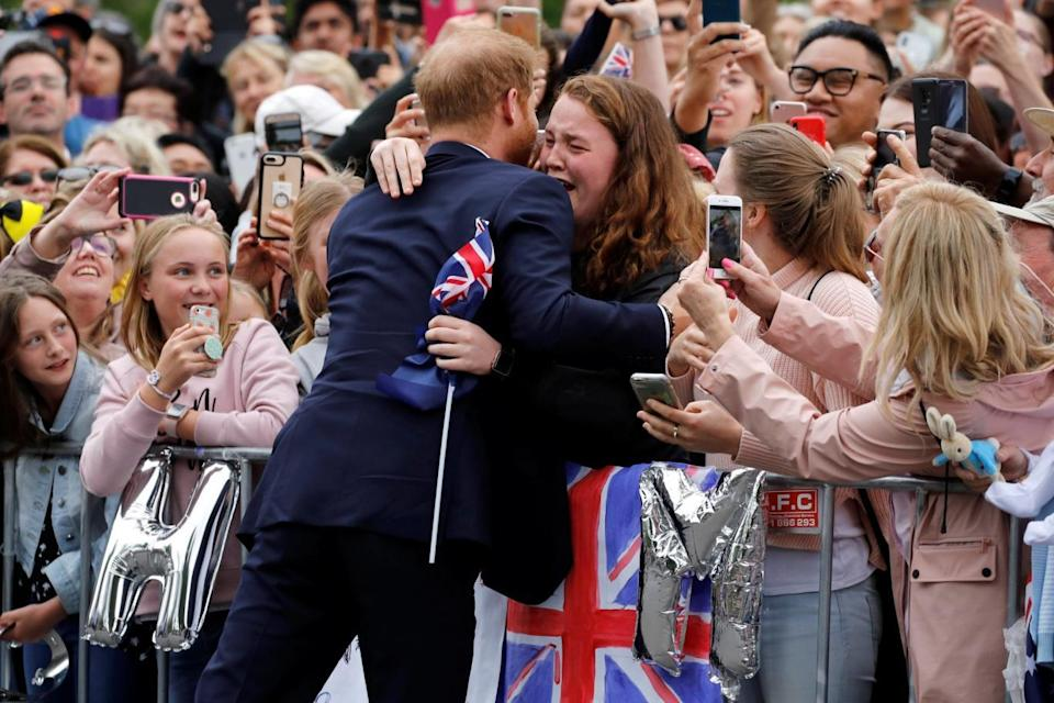 The Duke of Sussex hugs India Brown at the Royal Botanic Gardens in Melbourne (PA)