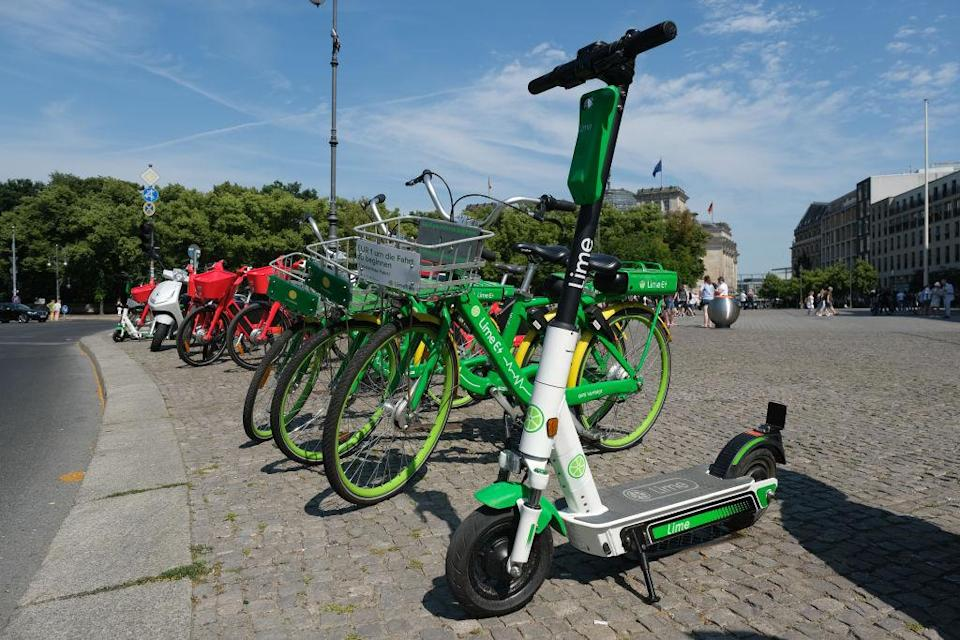 BERLIN, GERMANY - JUNE 19: An electric scooter from bike and scooter sharing company Lime stands near sharing bicycles in the city center on June 19, 2019 in Berlin, Germany. Lime has launched its scooter service in Berlin following the recent legalization of their use by the German government.