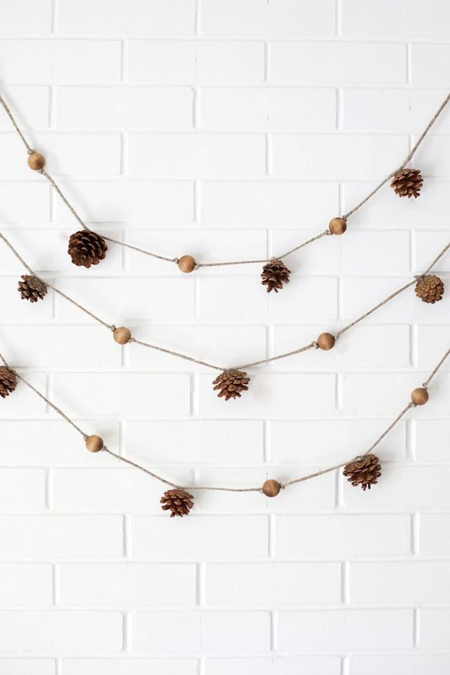 """<p>The best part of this garland is that it can be layered seamlessly with any other fall garlands you have around the house.</p><p><strong>Get the tutorial at <a href=""""https://abeautifulmess.com/2014/10/4-easy-fall-garlands.html"""" target=""""_blank"""">A Beautiful Mess</a>.</strong></p>"""