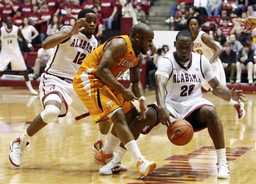 Alabama guard Andrew Steele (22) tries to keep control of the ball while being pressured by Tennessee's Trae Golden (11) as Alabama guard Trevor Releford (12) watches during the second half of an NCAA college basketball game, Saturday, Feb. 18, 2012, in Tuscaloosa, Ala. Alabama won 62-50. (AP Photo/The Tuscaloosa News, Michelle Lepianka Carter)
