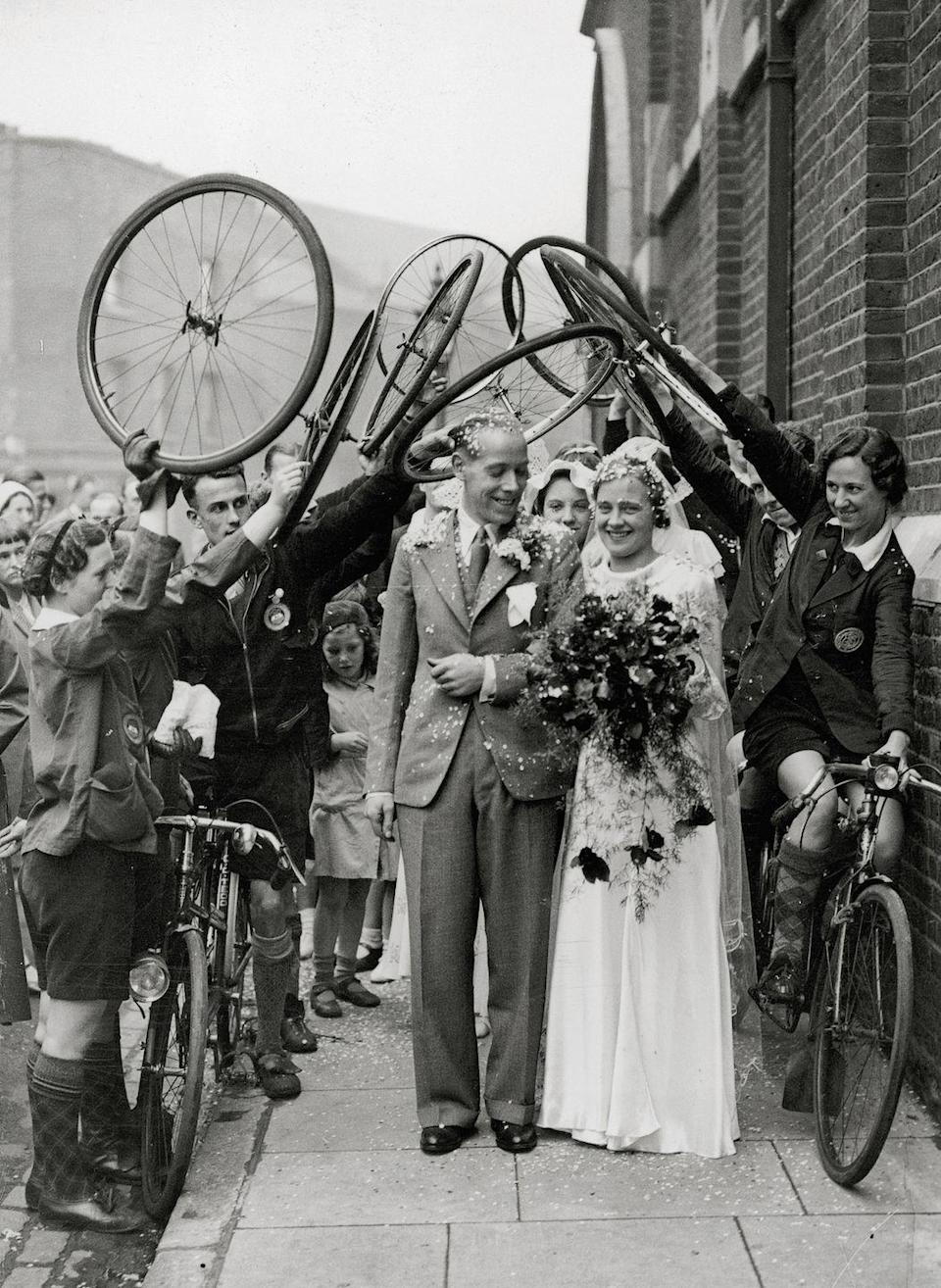 """<p>An arch fashioned by bicycles is very appropriate for this couple. After all, the groom was a professional cyclist. </p><p><a href=""""http://www.goodhousekeeping.com/life/relationships/news/a41070/wedding-photographers-share-signs-of-divorce/"""" rel=""""nofollow noopener"""" target=""""_blank"""" data-ylk=""""slk:10 confessions of wedding photographers »"""" class=""""link rapid-noclick-resp""""><em>10 confessions of wedding photographers »</em></a></p>"""
