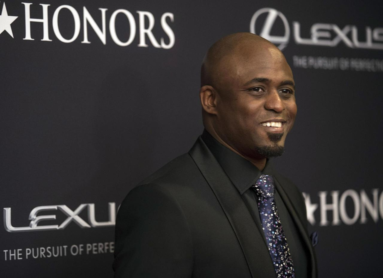 "FILE - In this Jan. 24, 2015, file photo, Wayne Brady arrives on the red carpet at the BET Honors 2015 at Warner Theater on in Washington. Producers of the hit musical ""Hamilton"" said Monday, Jan. 9, 2017, that the Emmy Award-winning comedian and game show host will play Aaron Burr from Jan. 17 until April 9 at The PrivateBank Theatre in Chicago. (Photo by Kevin Wolf/Invision/AP, File)"