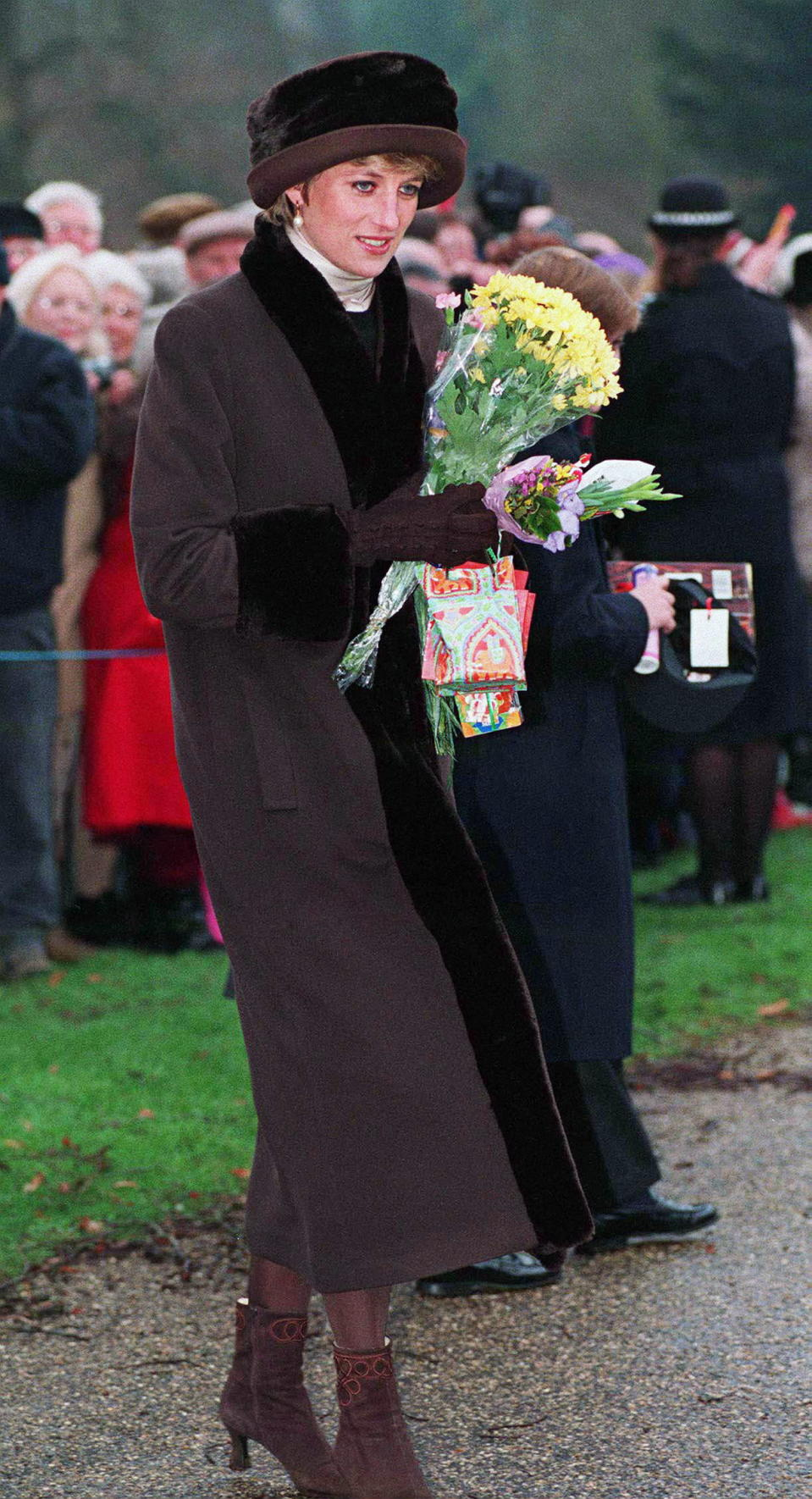 The Princess of Wales greeted members of the public in 1994 wearing a brown, fur-lined coat and matching hat. Photo: Getty Images