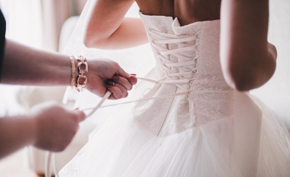 The bride pretended her bridesmaids' dresses cost more than they did [Photo: Getty]