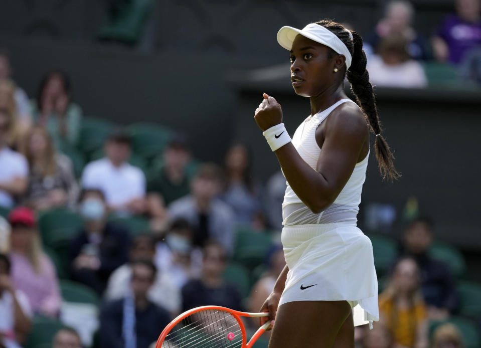 Sloane Stephens of the US celebrates winning a point against Czech Republic's Petra Kvitova during the women's singles match on day one of the Wimbledon Tennis Championships in London, Monday June 28, 2021. (AP Photo/Kirsty Wigglesworth)