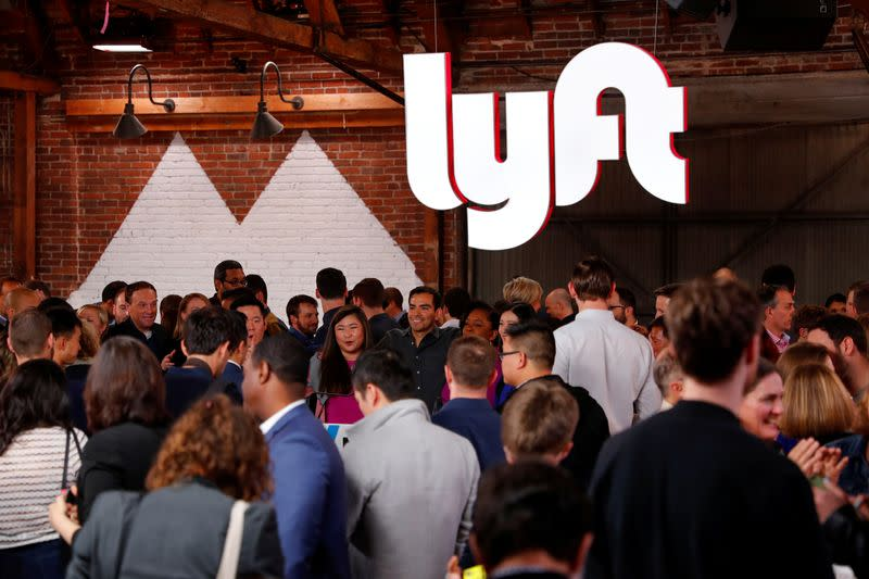 FILE PHOTO: People mingle following the 2019 listing of Lyft on the Nasdaq at an event in Los Angeles
