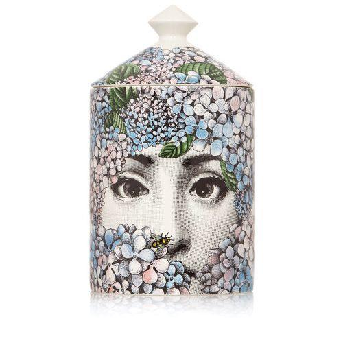 """<p>Fornasetti Ortensia </p><p>£155</p><p>Net-a-porter.com</p><p><a class=""""link rapid-noclick-resp"""" href=""""https://go.redirectingat.com?id=127X1599956&url=https%3A%2F%2Fwww.net-a-porter.com%2Fen-gb%2Fshop%2Fproduct%2Ffornasetti%2Fortensia-scented-candle-1-9kg%2F818242&sref=https%3A%2F%2Fwww.harpersbazaar.com%2Fuk%2Fbeauty%2Ffragrance%2Fg30698193%2Fbest-scented-candles%2F"""" rel=""""nofollow noopener"""" target=""""_blank"""" data-ylk=""""slk:SHOP NOW"""">SHOP NOW</a></p><p>Fornasetti's maximalist candles can fill a room with scent like no other. Powerful yet pretty, the white rose and jasmine blend in this hand-poured candle (created by renowned perfumer Emmanuel Philip) feels feminine yet sophisticated. The 60-hour burn time is impressive, too. </p>"""