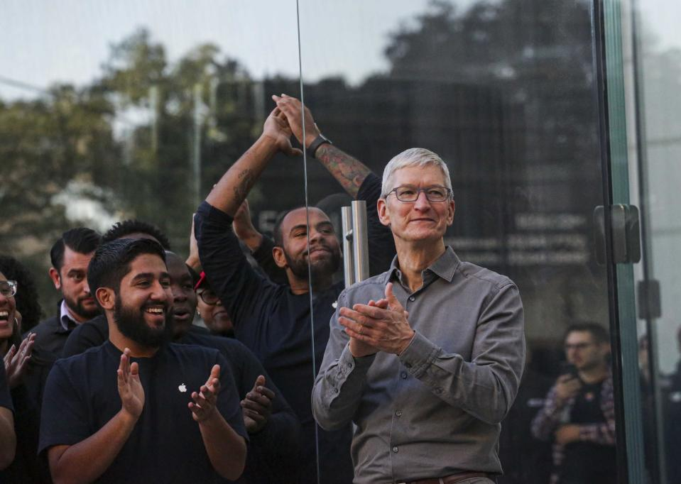 Apple CEO, Tim Cook openS the door of the newly renovated Apple Store at Fifth Avenue on September 20, 2019 in New York City. (Photo by Kena Betancur / AFP)        (Photo credit should read KENA BETANCUR/AFP via Getty Images)