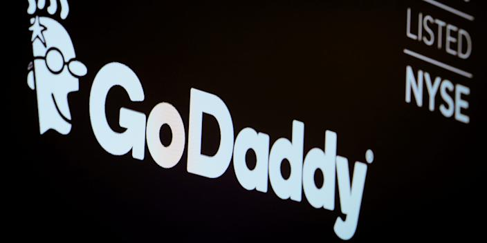 FILE PHOTO: The company logo and ticker for GoDaddy Inc. is displayed on a screen on the floor of the New York Stock Exchange (NYSE) in New York, U.S., March 4, 2019. REUTERS/Brendan McDermid