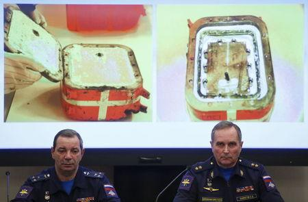 Sergei Bainetov (R), deputy chief of the Russian Armed Forces' flight safety service, and Nikolai Primak, chairman of the Air Accident Investigation Commission, attend a news conference, dedicated to the crash of SU-24 fighter-bomber, a Russian warplane shot down by Turkey in November, in Moscow, Russia, December 21, 2015. REUTERS/Maxim Shemetov