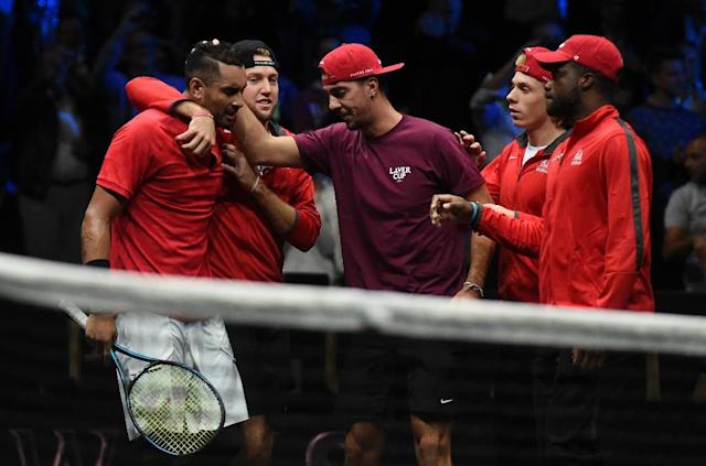 Nick Kyrgios of Team World is comforted by his teamates after his match against Roger Federer of Team Europe at the Laver Cup on September 24, 2017 in O2 Arena, in Prague (AFP Photo/Michal Cizek)