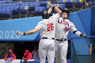 United States' Tyler Austin (23) celebrates his home run with teammate Triston Casas (26) in the fifth inning of a baseball game against the Dominican Republic at the 2020 Summer Olympics, Wednesday, Aug. 4, 2021, in Yokohama, Japan. (AP Photo/Sue Ogrocki)