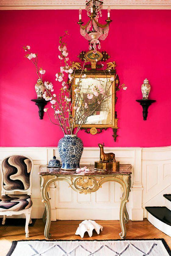 "<p>The unexpected, eye-catching hot pink walls deserve an equally dramatic console to accompany them. In this 19th-century <a href=""https://www.housebeautiful.com/design-inspiration/house-tours/g701/small-feminine-townhouse/"" rel=""nofollow noopener"" target=""_blank"" data-ylk=""slk:Brooklyn townhouse"" class=""link rapid-noclick-resp"">Brooklyn townhouse</a> by Jonathan Berger, this is accomplished by going ultra classic with an elaborate gilt mirror and console, a traditional chinoiserie vase filled with super tall cherry blossom branches, and a chandelier. The mod armchair mimics the undulations of the decorative shell. All together, they work wonders for a pleasant surprise. </p>"