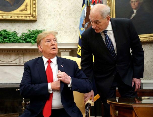 PHOTO: White House Chief of Staff John Kelly, right, leans in to talk with President Donald Trump in the Oval Office of the White House in Washington. (Pablo Martinez Monsivais/AP, FILE)