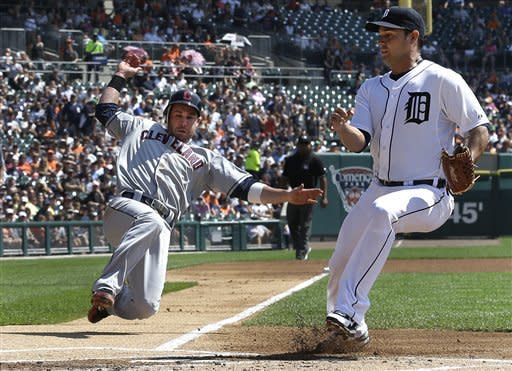 Cleveland Indians' Jason Kipnis slides safely into home plate to score as Detroit Tigers starting pitcher Anibal Sanchez, right, covers on a passed ball in the first inning of a baseball game in Detroit, Monday, Sept. 3, 2012. (AP Photo/Paul Sancya)