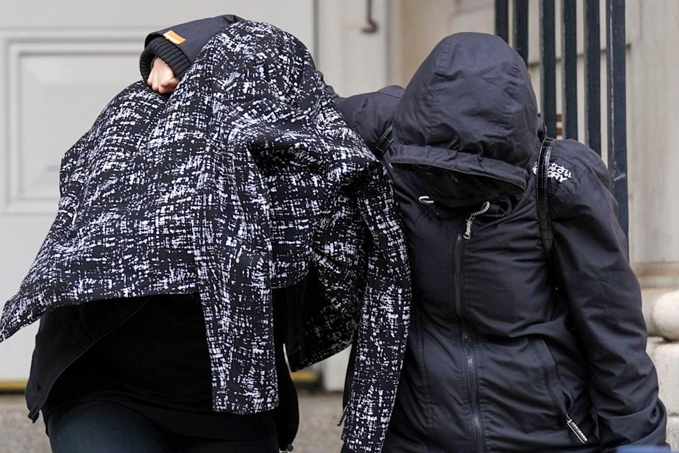 <p>Jennifer Johnson (left) leaves from Lewes Crown Court </p> (PA)