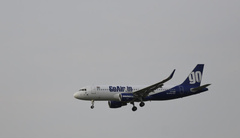 In this Thursday, April 16, 2015 photo, a passenger aircraft A320 of the GoAir Airlines prepares for landing at the Indira Gandhi International (IGI) Airport in New Delhi, India. (AP Photo/Altaf Qadri)