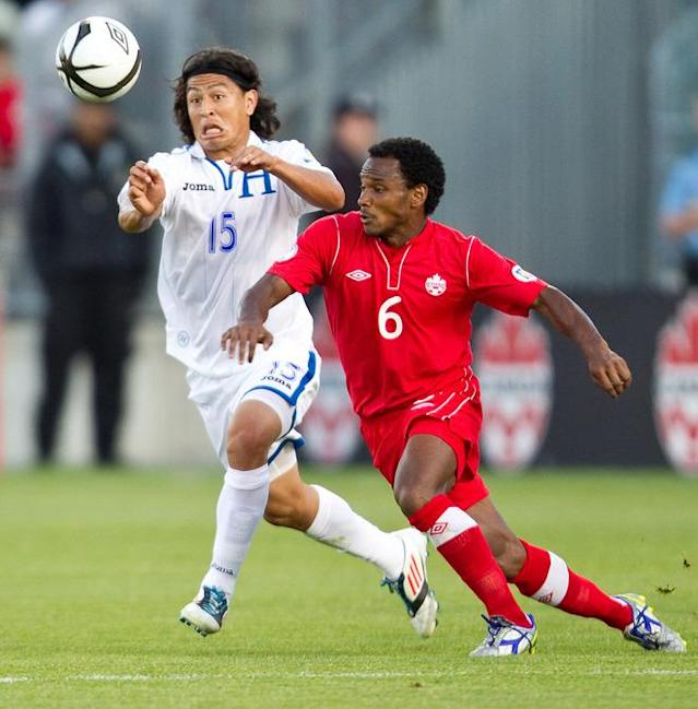 Roger Espinoza (L) of Honduras and Julian De Guzman of Canada fight for the ball during their FIFA 2014 World Cup Qualifier at BMO field in Toronto, Ontario, June 12, 2012. AFP PHOTO/Geoff RobinsGEOFF ROBINS/AFP/GettyImages