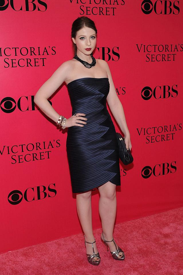 """Michelle Trachtenberg struck a pouty pose in a midnight blue dress and metallic heels. Bryan Bedder/<a href=""""http://www.gettyimages.com/"""" target=""""new"""">GettyImages.com</a> - November 19, 2009"""