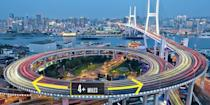 "<p><strong>Shanghai, China</strong></p><p>The Nanpu Bridge features an impressive seven-lane, 2,500-foot cable-stay component <a href=""http://hua.umf.maine.edu/China/p_Shanghai_Bund_history/01910228bwPudong.html"" rel=""nofollow noopener"" target=""_blank"" data-ylk=""slk:over the Huangpu River"" class=""link rapid-noclick-resp"">over the Huangpu River</a>. But honestly, it's the four miles of bridge that don't cross the river that offer the most intrigue. A circular elevated approach stretches from land and wraps up, bringing vehicles to the height of the crossing in the midst of the heavily congested downtown Shanghai.</p>"