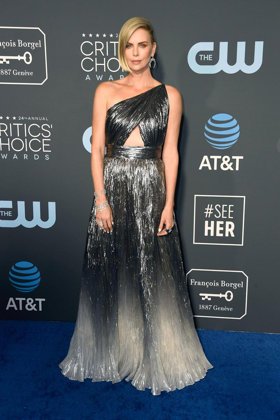 <p>Nominee Charlize Theron dazzled in a silver off-the-shoulder gown. Source: Getty </p>