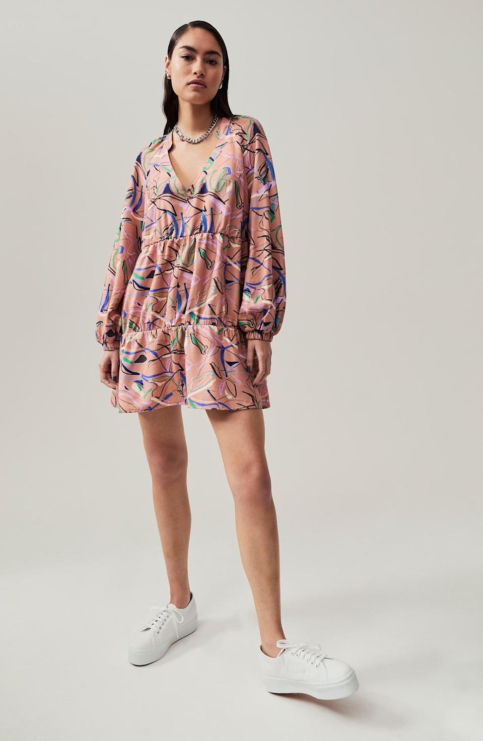<p>This <span>Open Edit Long Sleeve Tiered Babydoll Dress</span> ($59) looks modern and visually stunning.</p>