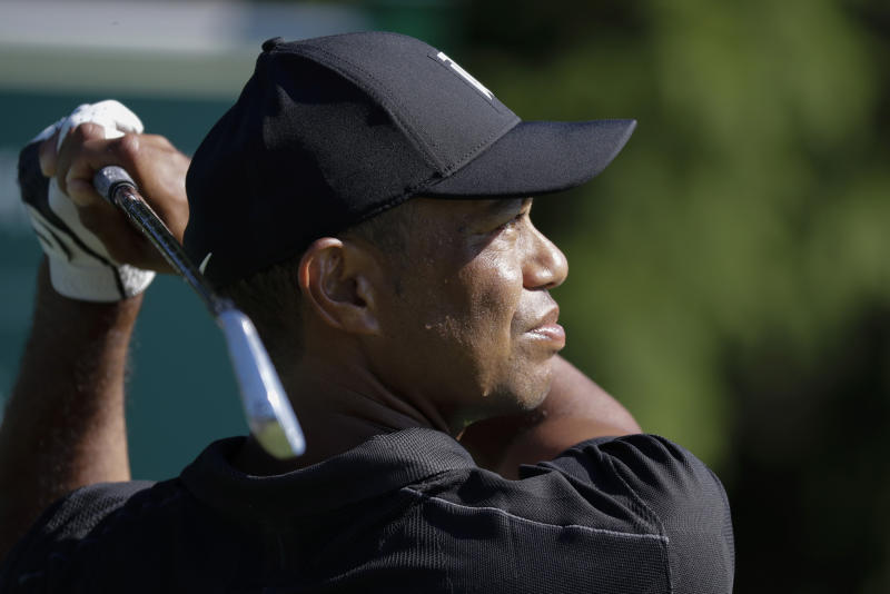 Pictured here, Tiger Woods watches his tee shot during practice for the Memorial golf tournament.