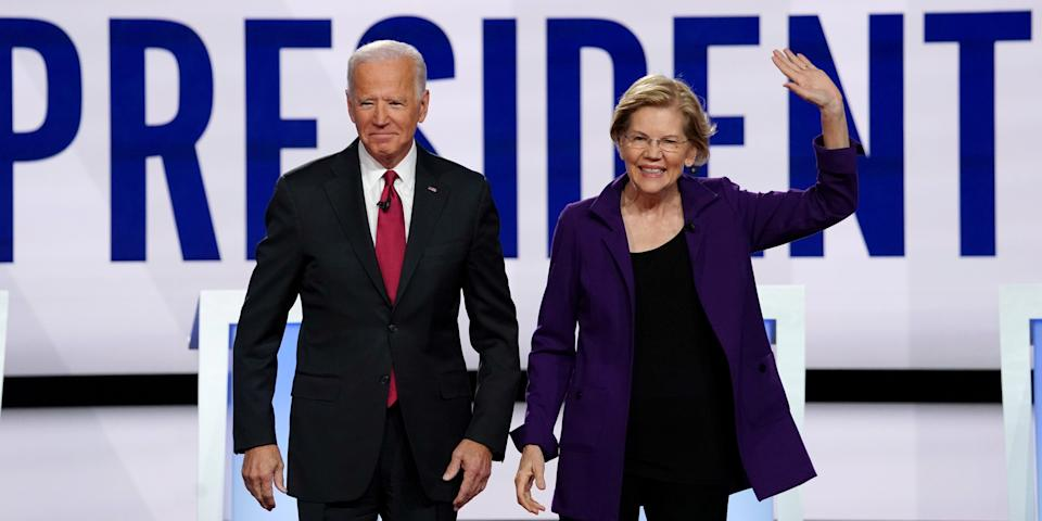 FILE PHOTO: Democratic presidential candidates former Vice President Joe Biden and Senator Elizabeth Warren pose together at the start of the fourth U.S. Democratic presidential candidates 2020 election debate at Otterbein University in Westerville, Ohio U.S., October 15, 2019. REUTERS/Shannon Stapleton/File Photo