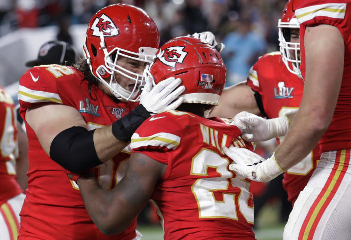 Kansas City Chiefs' Damien Williams (26) celebrates with teammates after scoring against the San Francisco 49ers during the second half of the NFL Super Bowl 54 football game Sunday, Feb. 2, 2020, in Miami Gardens, Fla. (AP Photo/Lynne Sladky)