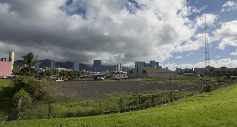 This Tuesday, Dec. 24, 2013 photo shows one possible location in the Kakaako district of Honolulu to be considered for the Barack Obama Presidential Library. The location is considered prime real estate with views of the ocean and Koolau mountains. (AP Photo/Eugene Tanner)